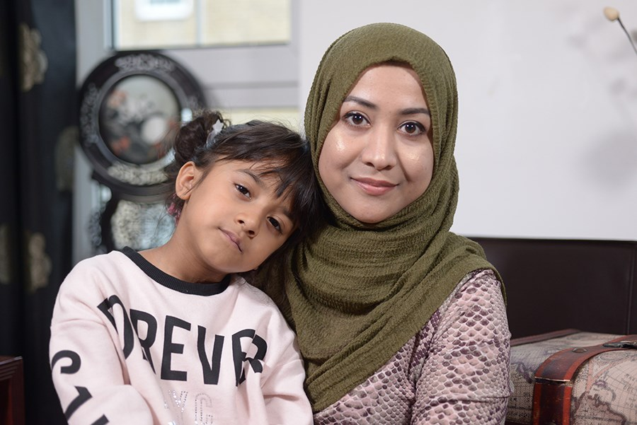Farhana and her daughter in their home in Wapping Housing Estate, Tower Hamlets