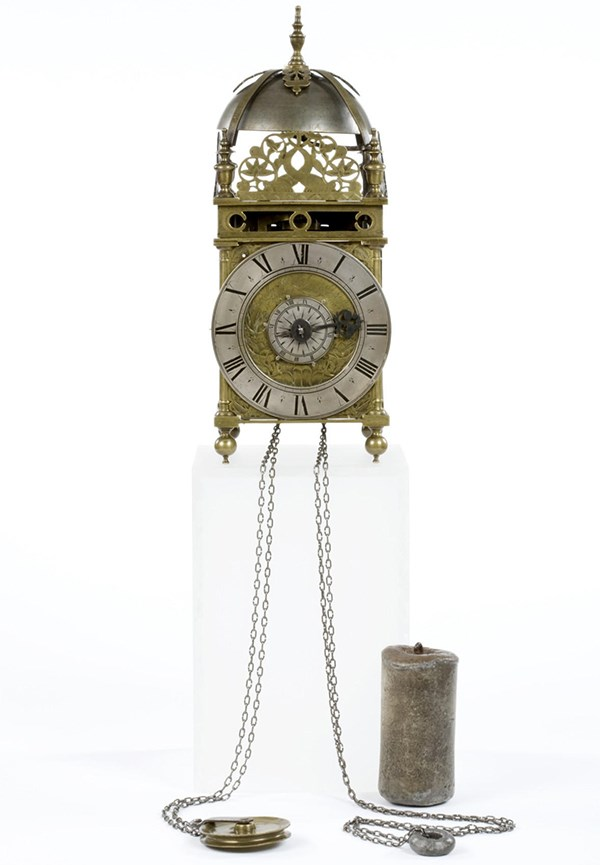 Brass and metal lantern clock on four ball feet, made by Robert Robinson in Lothbury, City of London, c.1660-1670. Object number 54/2006