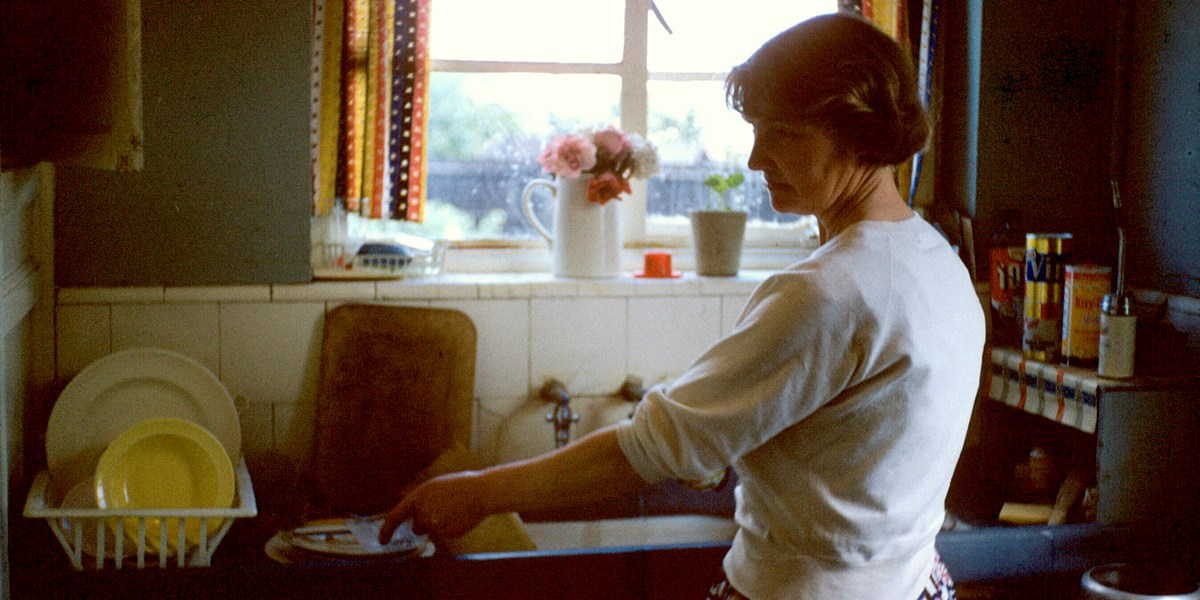 Muriel Scagell at the kitchen sink at home in Middlesex, c.1961. © Scagell family