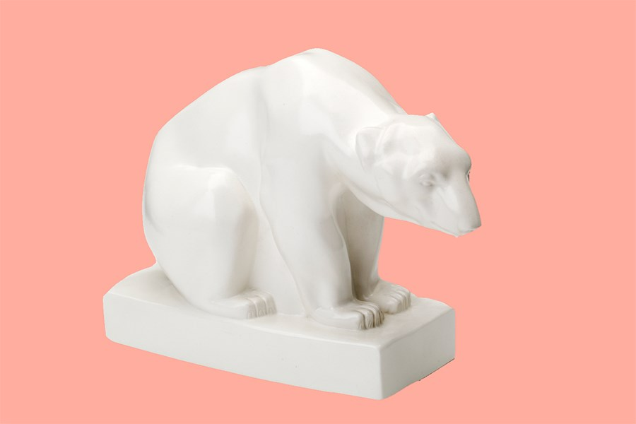 Polar bear figure made from matt white glazed earthenware, designed by John Skeaping in 1927 and manufactured by Wedgwood, Stoke-on-Trent, until 1950. Object number 177/1998